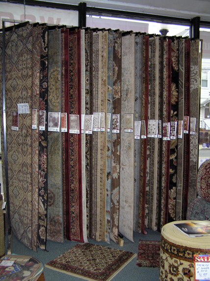 custom area rugs rack